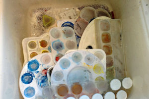 Cleaning up in my studio: way too many dirty palettes!